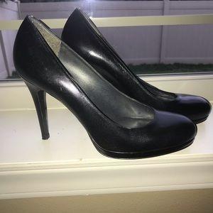 Stuart Weitzman platform stiletto heels.